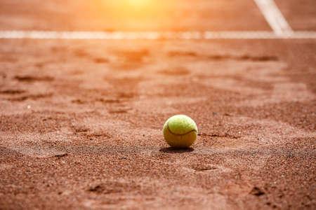 Ball on a clay tennis court Stock fotó