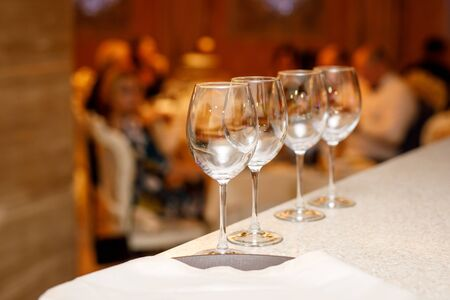 A row of empty wine glasses at a banquet