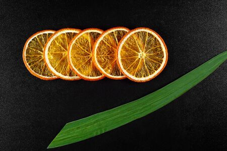 Pieces of dried orange on a black background