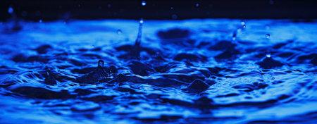 Blue water splashing. Liquid drops Standard-Bild
