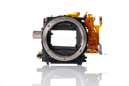 Detail from a modern camera on a white background. Content for the repair of photographic equipment 版權商用圖片