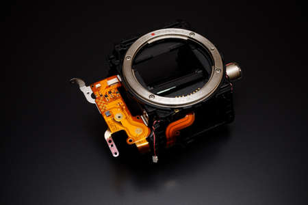 Detail from a modern camera on a black background. Content for the repair of photographic equipment