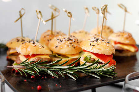 Close-up burgers at catering event.