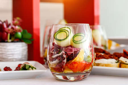 Glass with food appetizer on a table