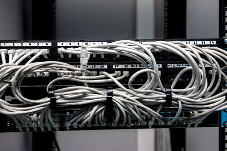 Network panel, switch and cables in data center 版權商用圖片