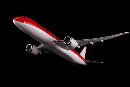 Commercial Airplane on isolated black background Reklamní fotografie