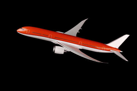 Commercial Airplane on isolated black background