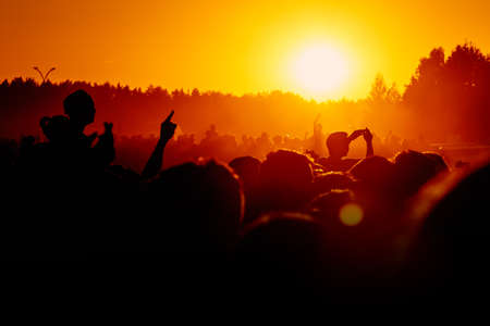 Silhouette of people on a big festival event
