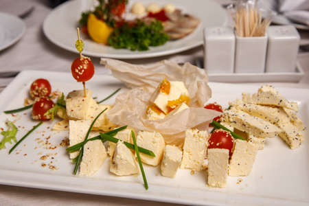 Various type of cheese on banquet table Stock Photo