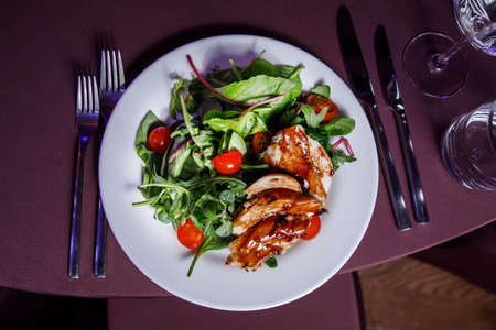 Vegetable salad with chiken fillet on a banquet. Stock Photo