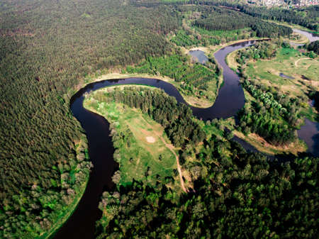 Aerial view of the forest river.