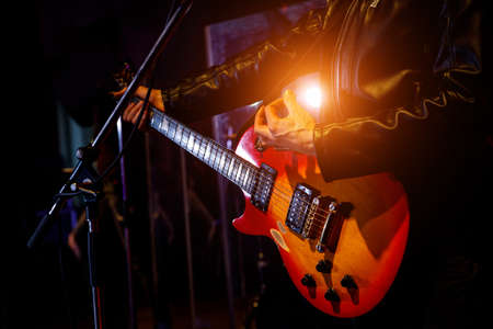 Guitar during a concert. Guitarist on stage. Stock Photo