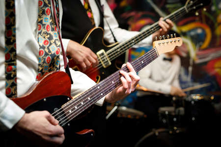 Guitars during a concert. Guitarists on a stage. Stock Photo