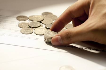 Thai money and right Hand with financial concept Stock Photo
