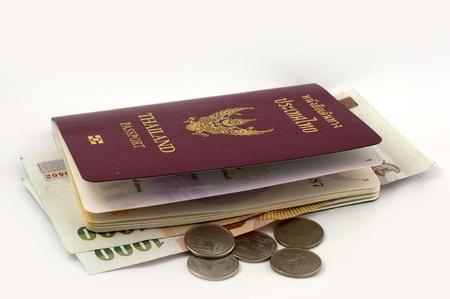 Thai passport and Thai Coins on white background