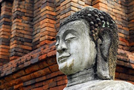 Thai Buddha face on brick wall background