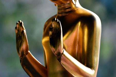 composed: Buddha statue standing composed  Stock Photo