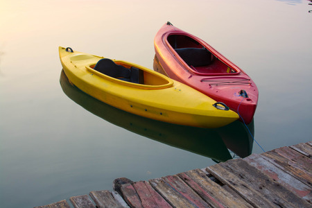 Yellow and Red Kayak on the lake photo