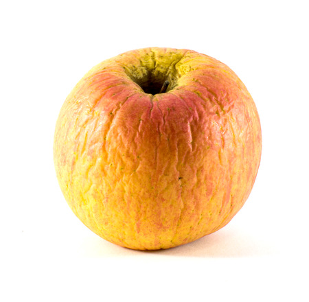 Withered Apple on white background , Healthy concept photo