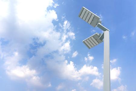 Street light pole with blue sky background. Foto de archivo