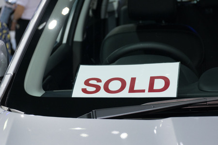 car showroom: Sold label in the new car at car showroom