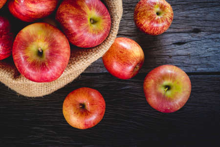 apples in bag on wood background