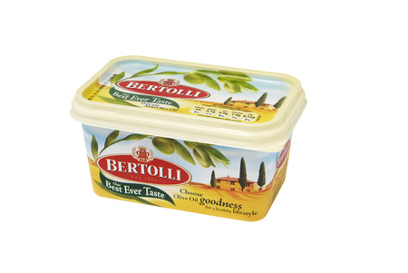 margarine: Leeds, United Kingdom - July 5th, 2011: A tub of Bertolli Olive Oil spread, used as a substitute for butter or margarine. Bertolli is the worlds market leader of olive oil production. Bertolli spread is made in the UK using Mediterranean olive oil. Editorial