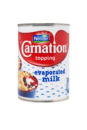 nestle: Leeds, United Kingdom - July 5th, 2011: Can of Carnation evaporated milk. Studio shot isolated on white. Nestle is one of the largest food companies in the world.