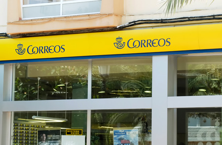 shopfront: Santa Eulalia, Ibiza, Spain - August 29th, 2013: Exterior shopfront of Spanish Correos (post office) in Ibiza, Spain. Santa Eulalia is a resort on the east coast of the island of Ibiza, popular with tourists from all over Europe