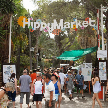 cana: Es Cana, Ibiza, Spain - August 28th, 2013: Lots of people walking to the entrance of the hippy market in the resort of Es Cana Ibiza. The market is held every Wednesday during the summer months, selling local arts and crafts, clothing etc. In 2013 the mar