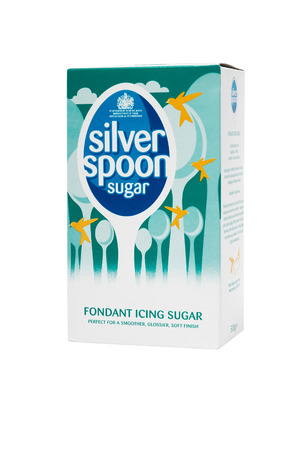 british foods: Leeds, United Kingdom - July 5th, 2011: Box of Silver Spoon fondant icing sugar. Studio shot isolated on white. British Sugar plc is a subsidiary of Associated British Foods and is the only producer of sugar in Britain. Formed in 1936 as British Sugar Cor