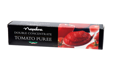 tomato puree: Leeds, United Kingdom - July 5th, 2011: apolina tomato puree in packaging. Studio shot isolated on white with path. Napolina is a manufacturer of Italian food ingredients. Established in Italy by Marino Landiorio, and launched in the UK in 1965 Editorial