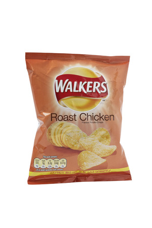 potato crisps: Leeds, United Kingdom - July 7th, 2011: A 25g packet of Walkers Roast Chicken flavor potato crisps. Walkers, a British snack food manufacturer is a subsidiary of PepsiCo Editorial