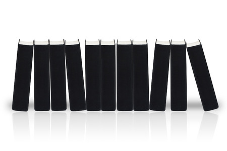 printed matter: A row of black books isolated on white