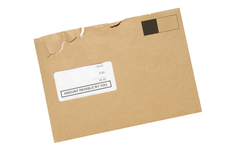 payable: A Manilla envelope opened containing a bill, isolated with path