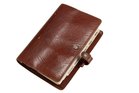 personal organiser: Brown leather old personal organiser isolated on white with path