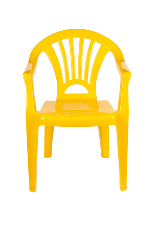 patio chair: Yellow plastic chair isolated on white with path