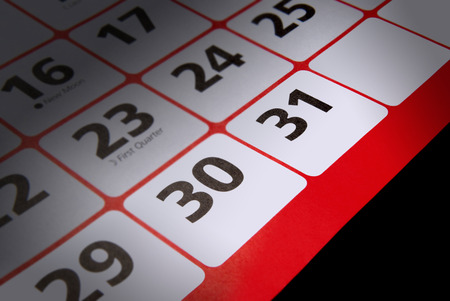 signify: Calendar close up with narrow depth of focus showing last two days of the month to signify a deadline Stock Photo