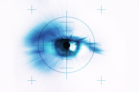 centred: Concept of eyesight, closeup of one eye with a target centred