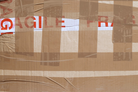 packing tape: Closeup of the side of a boxed parcel with packing tape Stock Photo