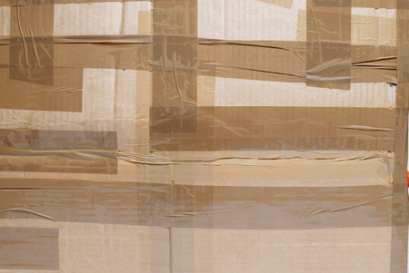 packing tape: Closeup of cardboard parcel with packing tape