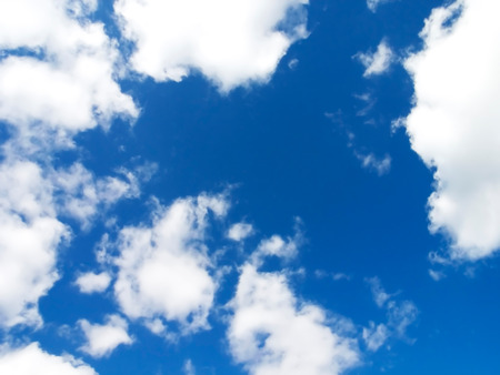 skyscape: Skyscape showing deep blue sky with fluffy white clouds Stock Photo
