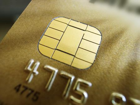 chip and pin: Macro close up of gold credit card chip and pin, narrow depth of focus Stock Photo