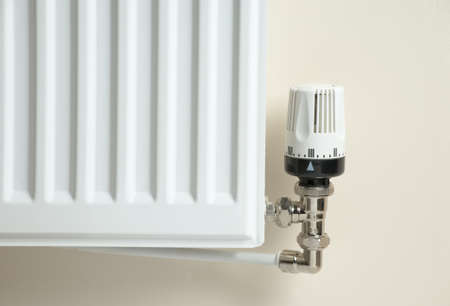 pipework: Corner of a domestic radiator, showing the temperature control valve Stock Photo