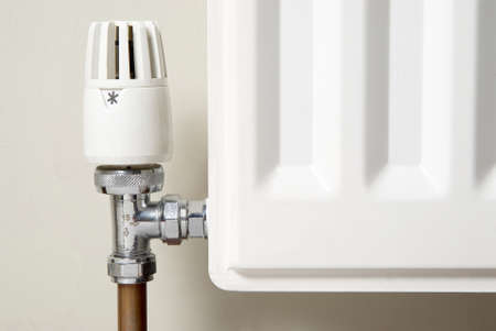 pipework: corner of a heating system radiator showing the temperature valve