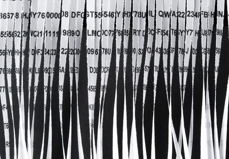 secret code: Closeup of paper document shredding Stock Photo