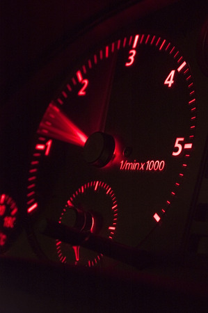 rev: Closeup of a red rev counter in a car