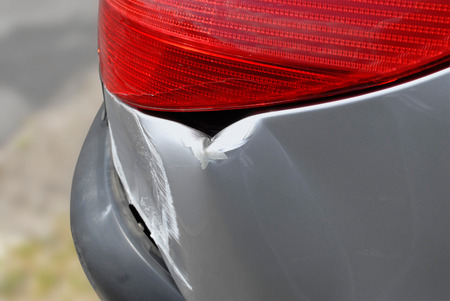 bodywork: Close up of accident damage to the rear of a car