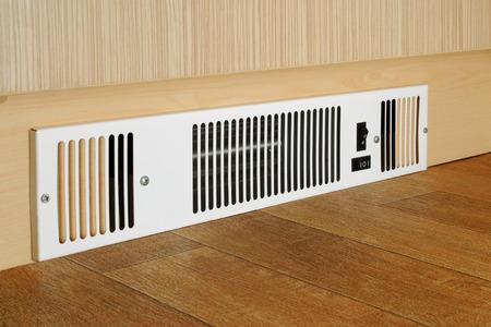 floor level: A floor level electric fan heater fitted into a kitchen kickboard