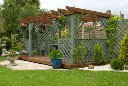 decking: A pergola in an English urban garden